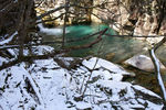 Title: Emerald Water and Snow