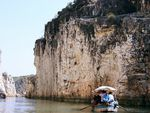 Title: Boating BesideTowering Cliffs