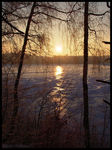 Title: Sunset over frozen lake